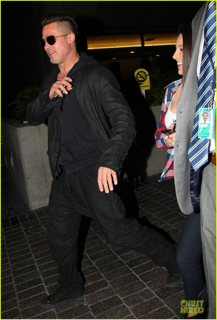 brad pitt lax arrival after angelina jolie difret news 08