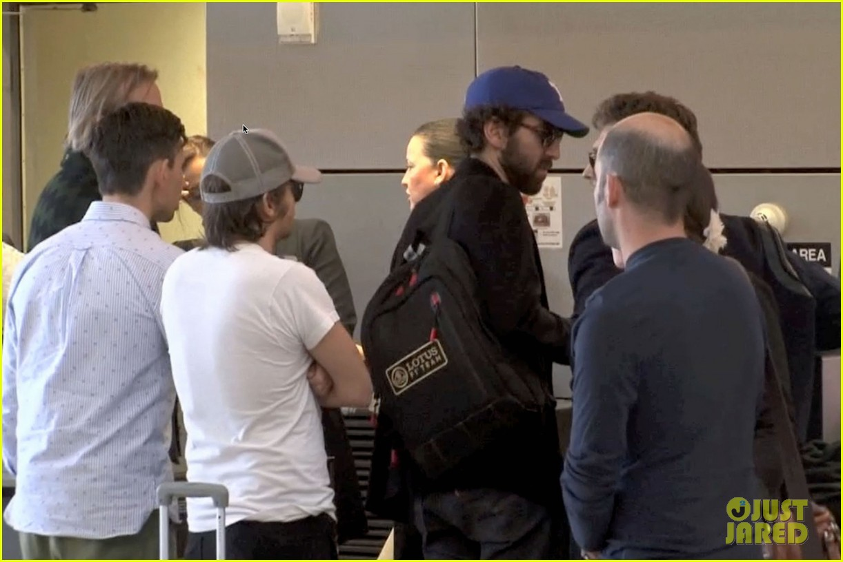 daft punk guys take helmets off for flight out of los angeles 05