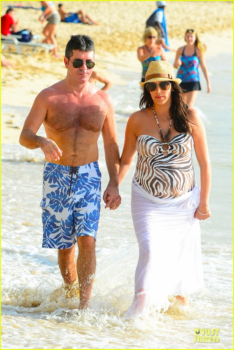 simon cowell lauren silverman hold hands on new year eve 03