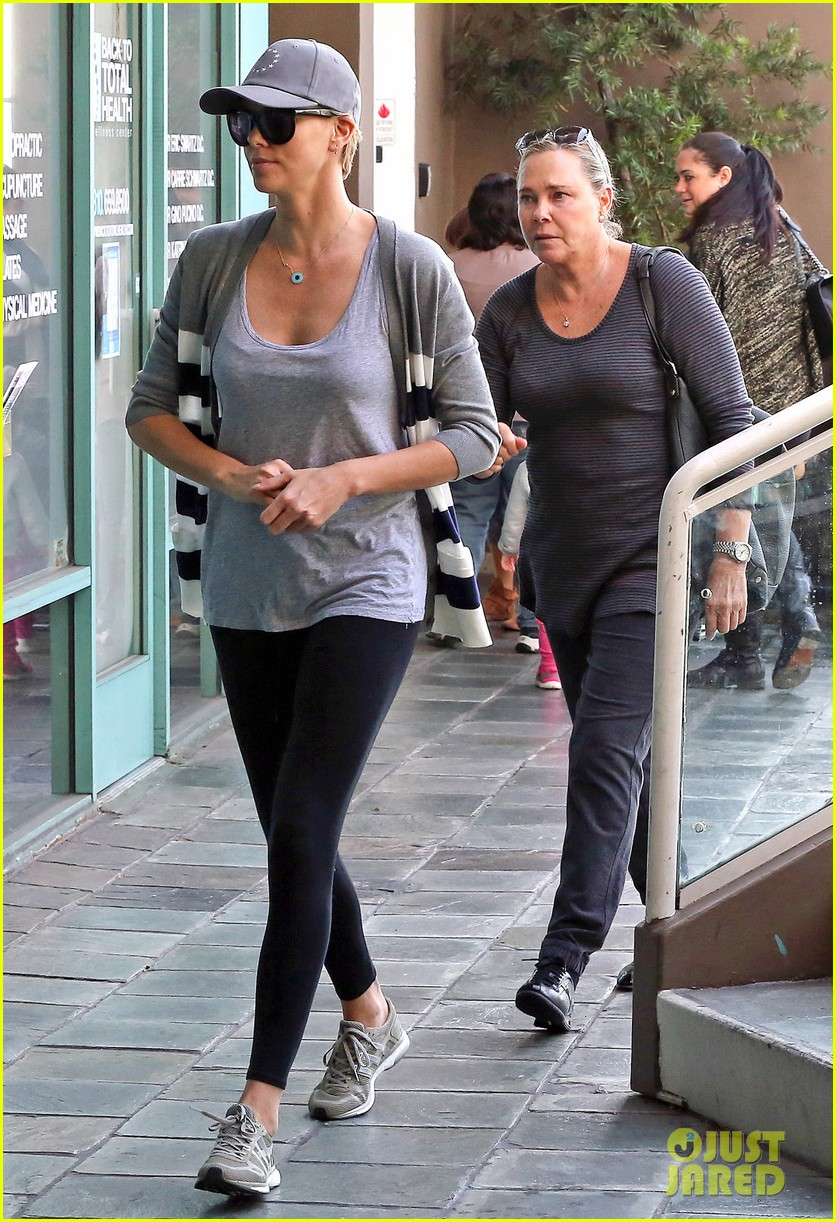 charlize theron takes caped crusader jackson to the gym 06