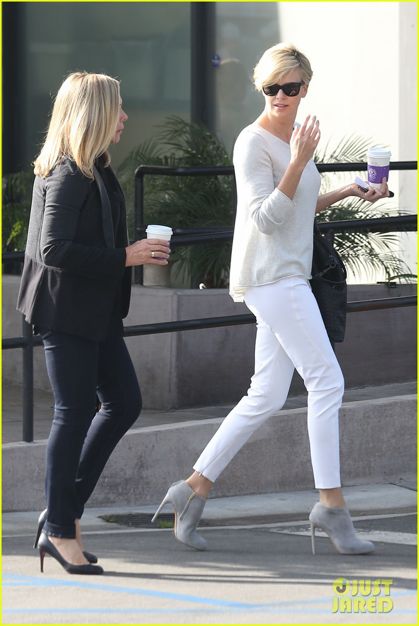 charlize theron vision in white for coffee run 01