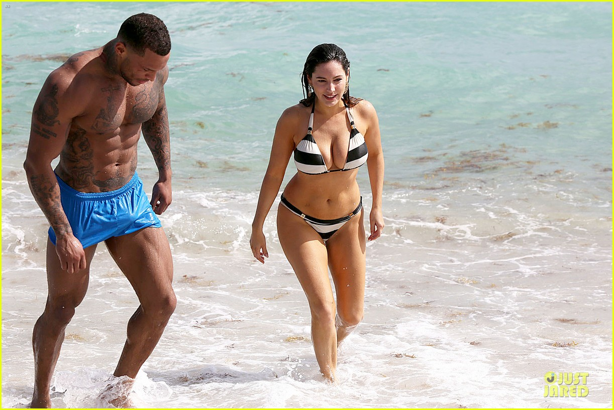 kelly brook frolicks on the beach with boyfriend david mcintosh 11