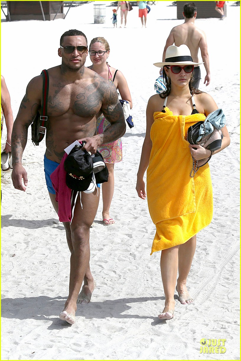 kelly brook frolicks on the beach with boyfriend david mcintosh 133047543