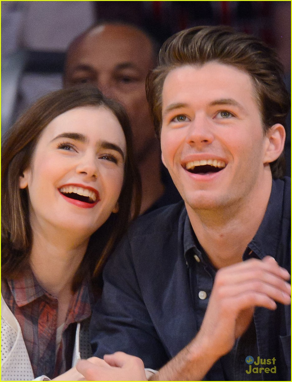 lily collins boyfriend thomas cocquerel hold hands at lakers game 05