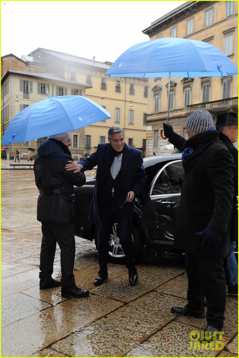 matt damon george clooney get personal umbrella holders in milan 103050718