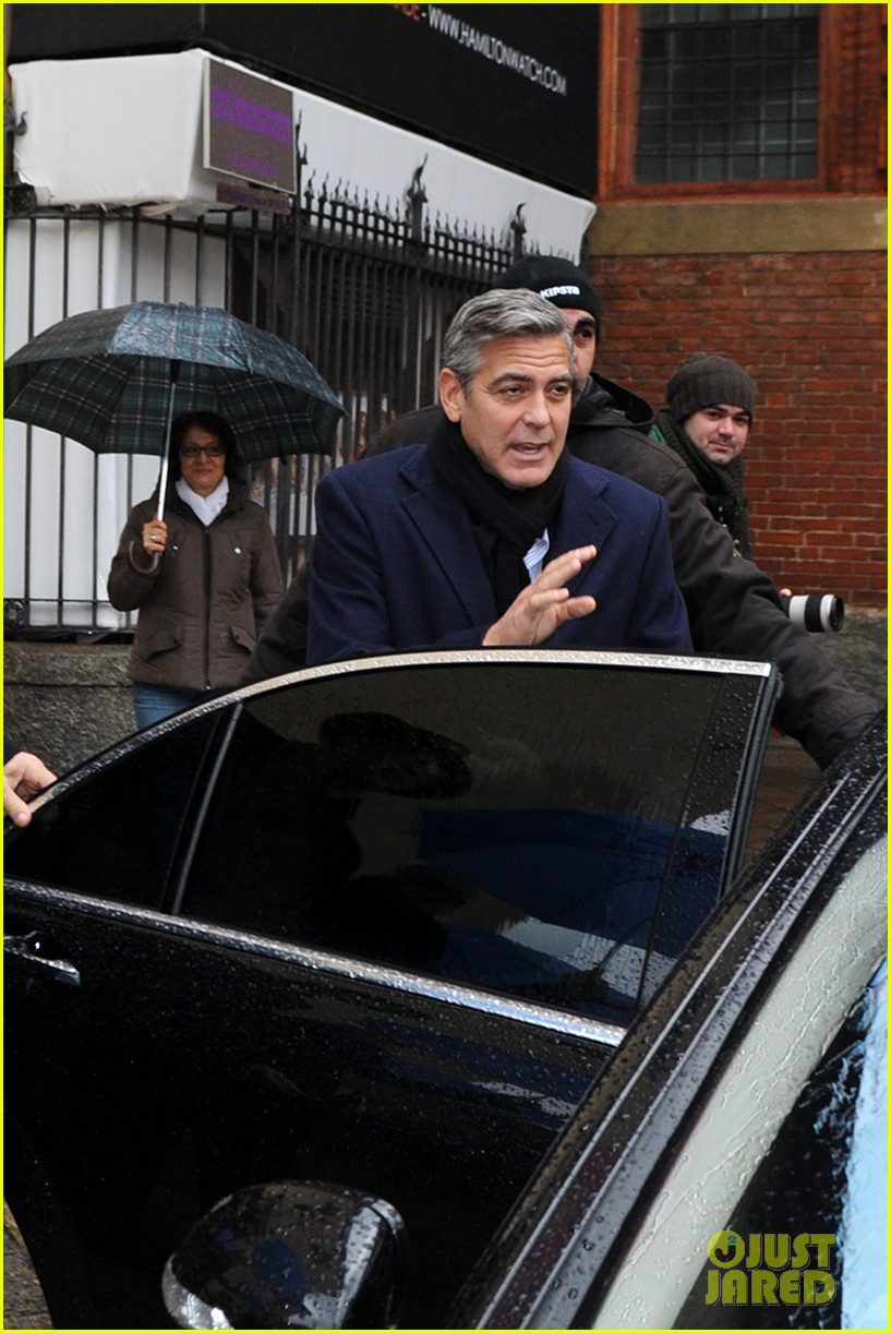 matt damon george clooney get personal umbrella holders in milan 16