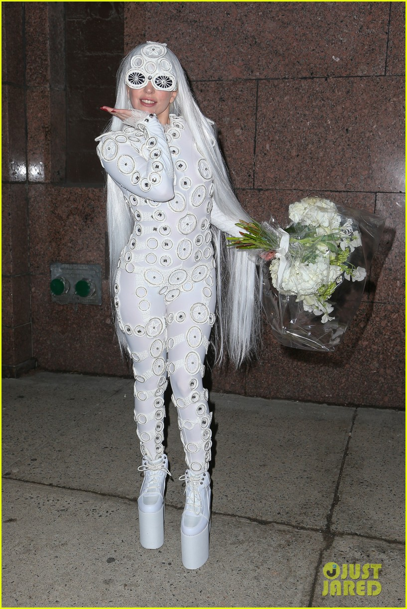 lady gaga is a bride see her throwing a bouquet of flowers 033057623