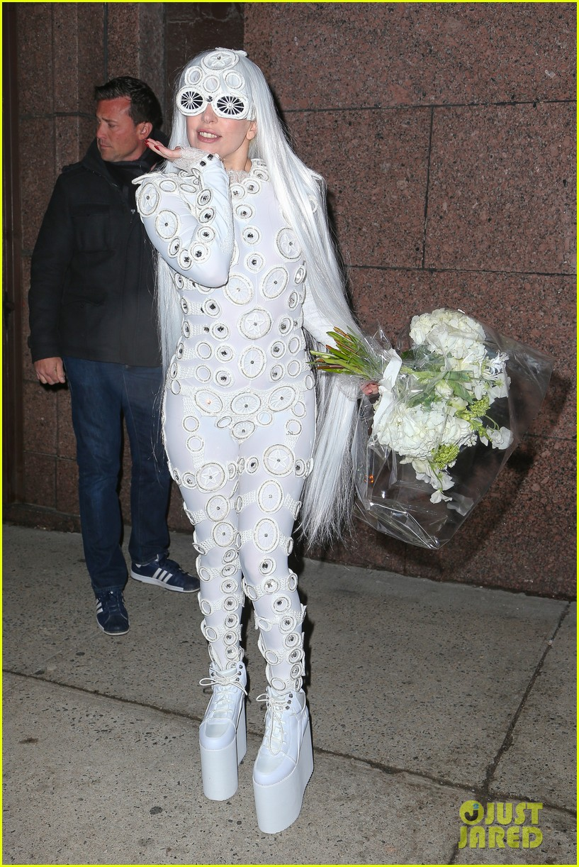 lady gaga is a bride see her throwing a bouquet of flowers 13
