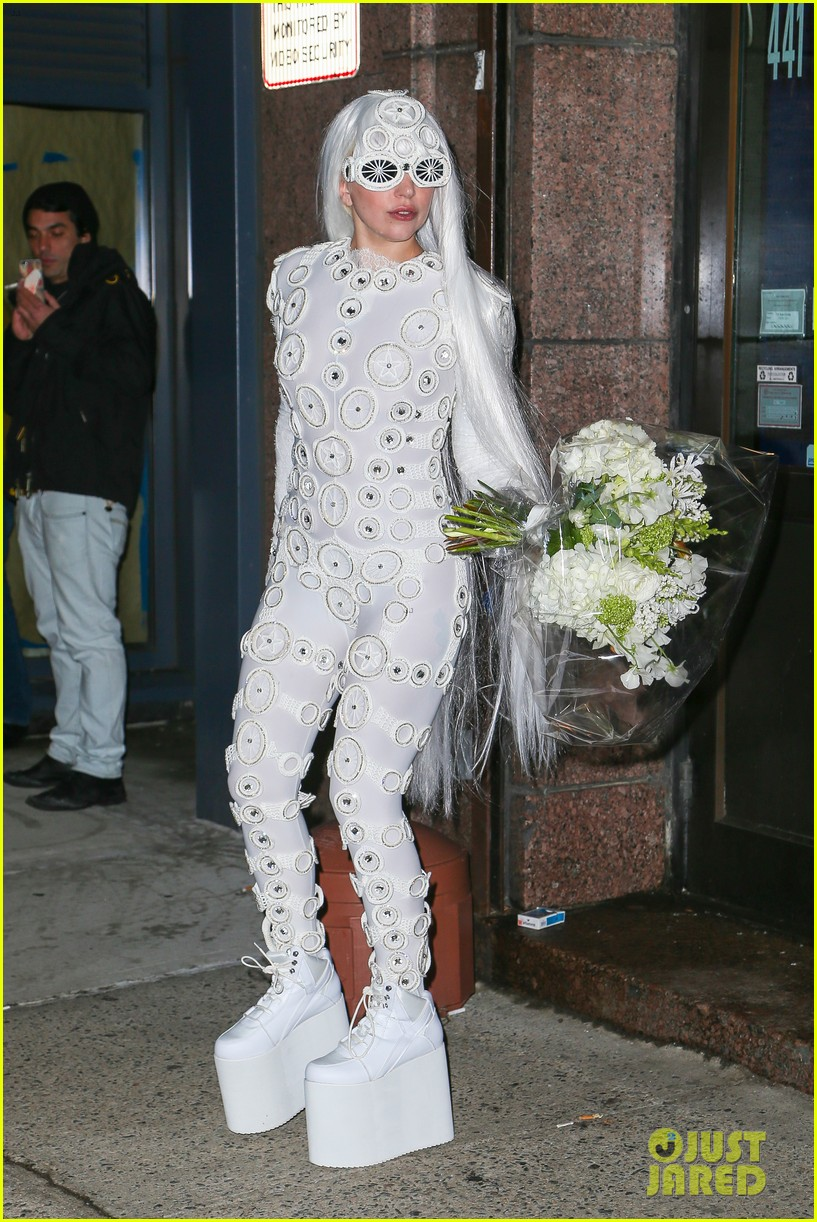 lady gaga is a bride see her throwing a bouquet of flowers 213057641
