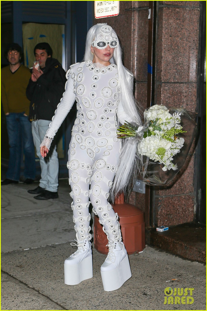 lady gaga is a bride see her throwing a bouquet of flowers 233057643