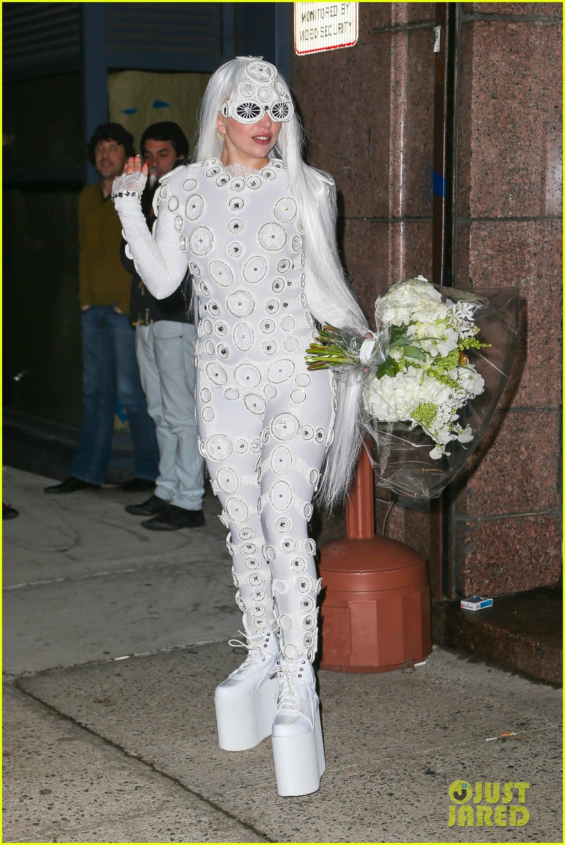 lady gaga is a bride see her throwing a bouquet of flowers 25