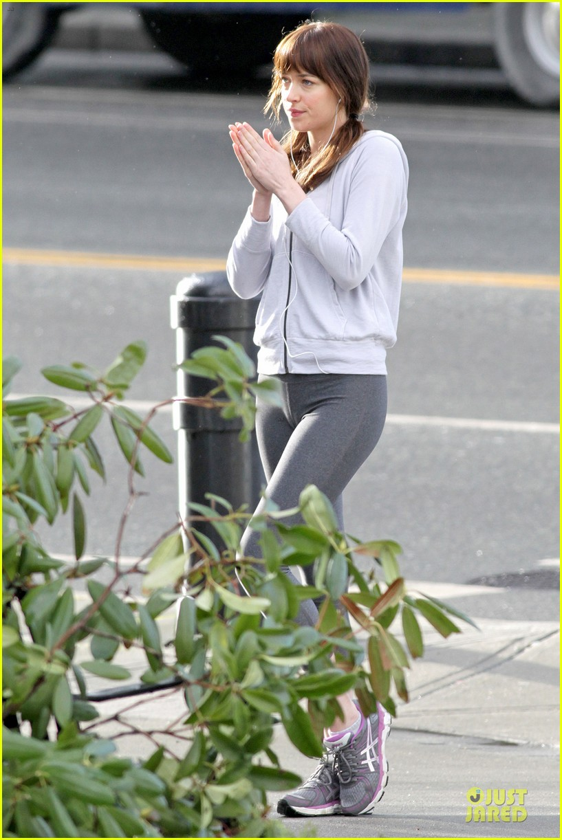 dakota johnson runs for fifty shades in pigtails 15
