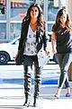 kim kardashian bares cleavage in black cut out shirt 03