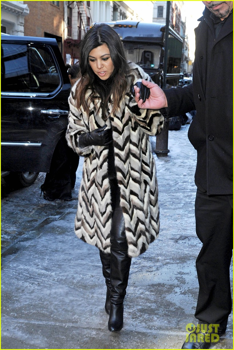 kim kardashian films kuwtk with her sisters khloe sends message on coat fxck yo fur 05