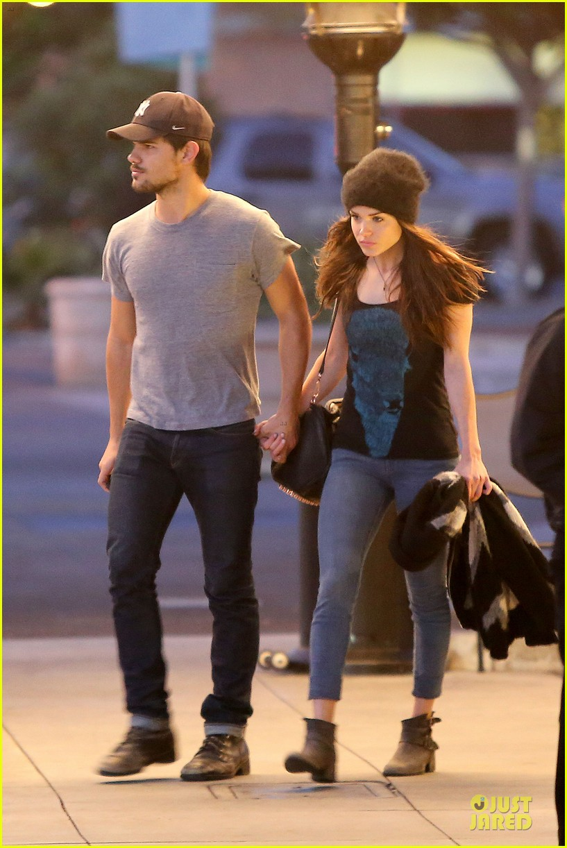 taylor lautner marie avgeropoulos hold hands for dinner 033047577