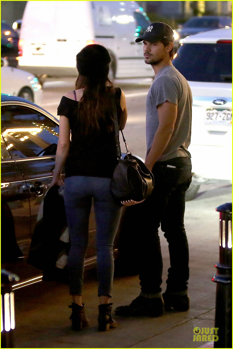 taylor lautner marie avgeropoulos hold hands for dinner 11