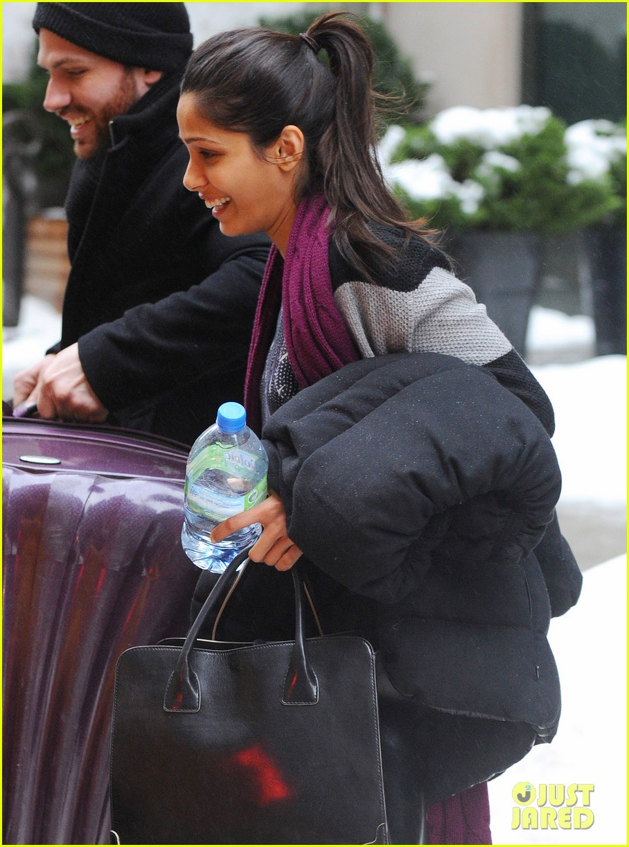 freida pinto laughs off giant snow slush piles in nyc 04