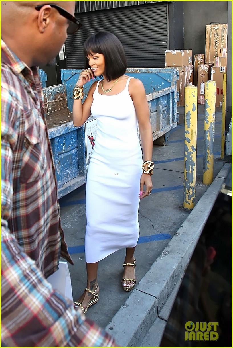 rihanna wears sleek white dress to shop at moncler 12