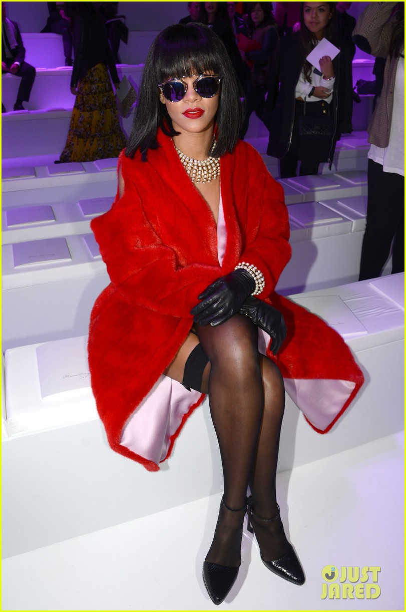 rihanna covers up sexy black outfit with red coat 013062314
