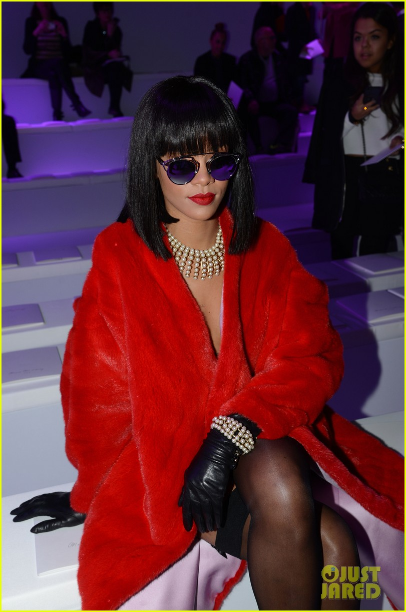 rihanna covers up sexy black outfit with red coat 043062317