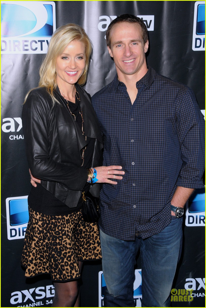 tim tebow eli manning football studs at directv super bowl party 123046332