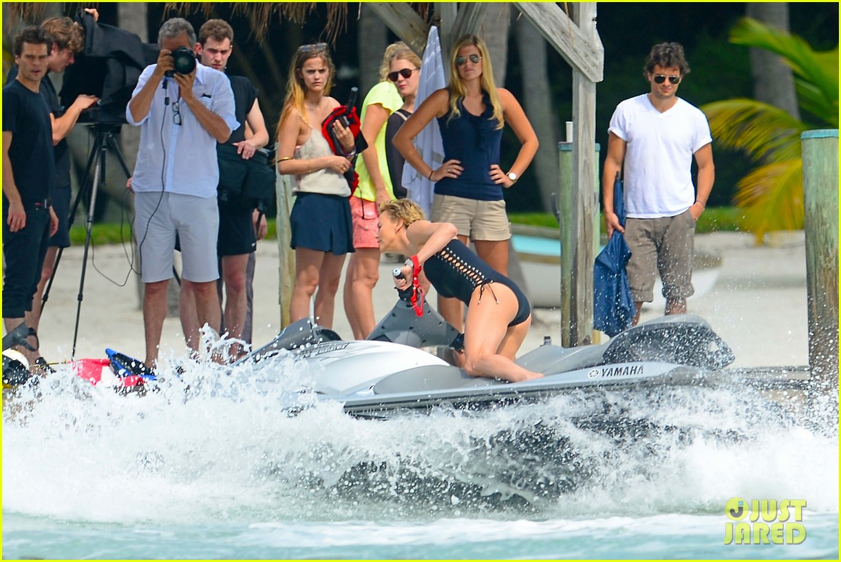 charlize therons bathing suit body is so enviable during jet ski shoot 17