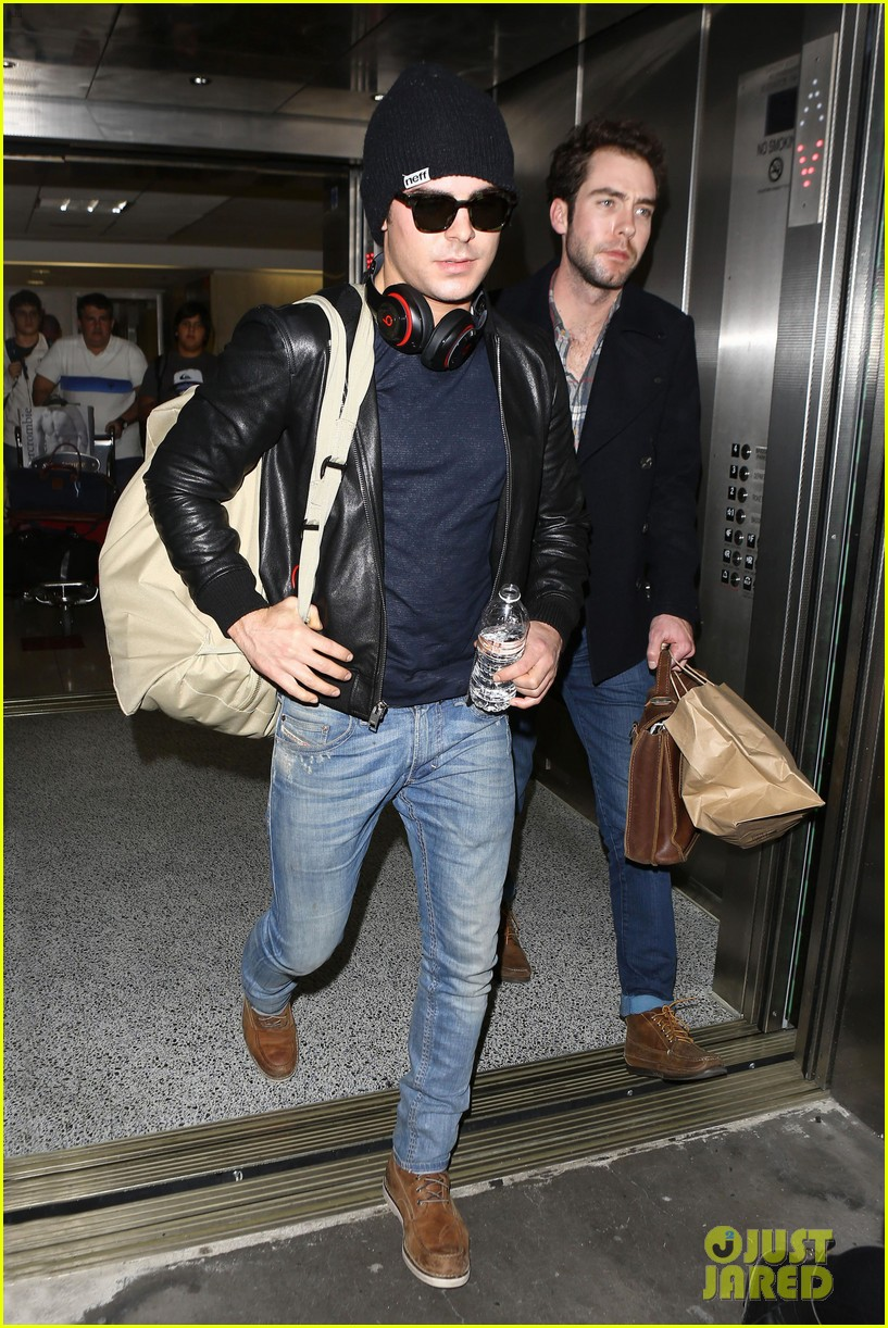 zac efron ashton kutcher fly out of austin after sxsw 06