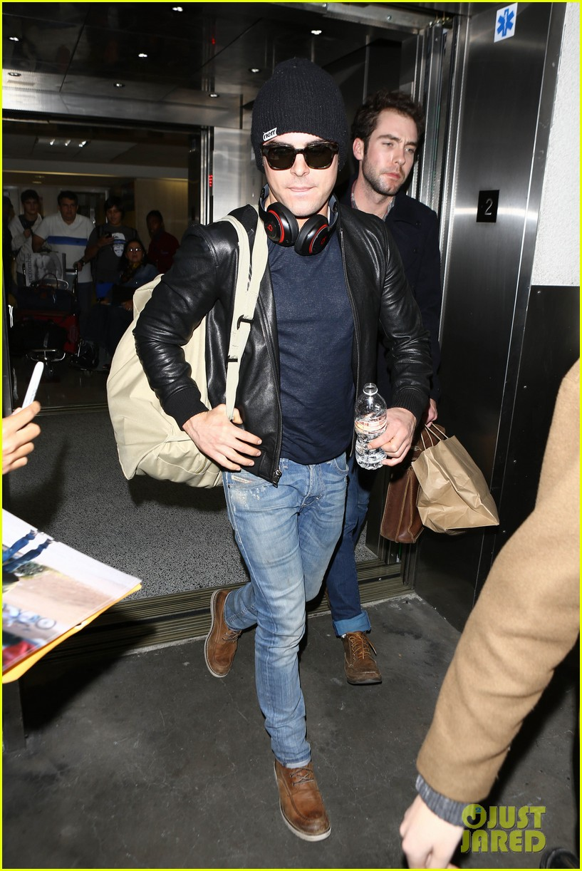 zac efron ashton kutcher fly out of austin after sxsw 19