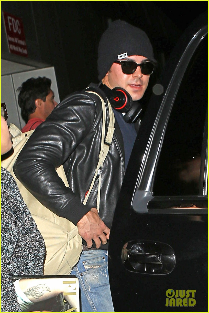zac efron ashton kutcher fly out of austin after sxsw 30