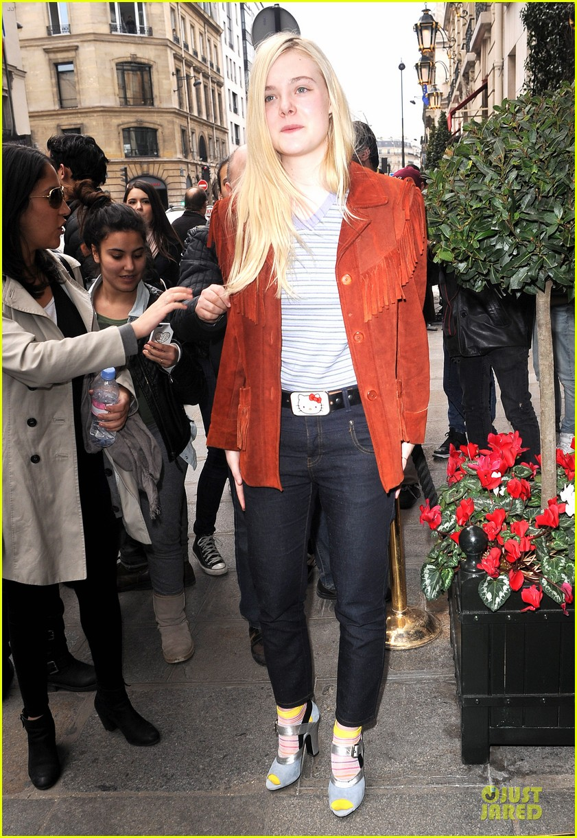 elle fanning makes a fringe fashion statement in france 113066107