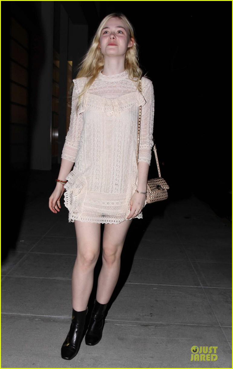 elle fanning teases the cameras in sheer dress at mr chow 10