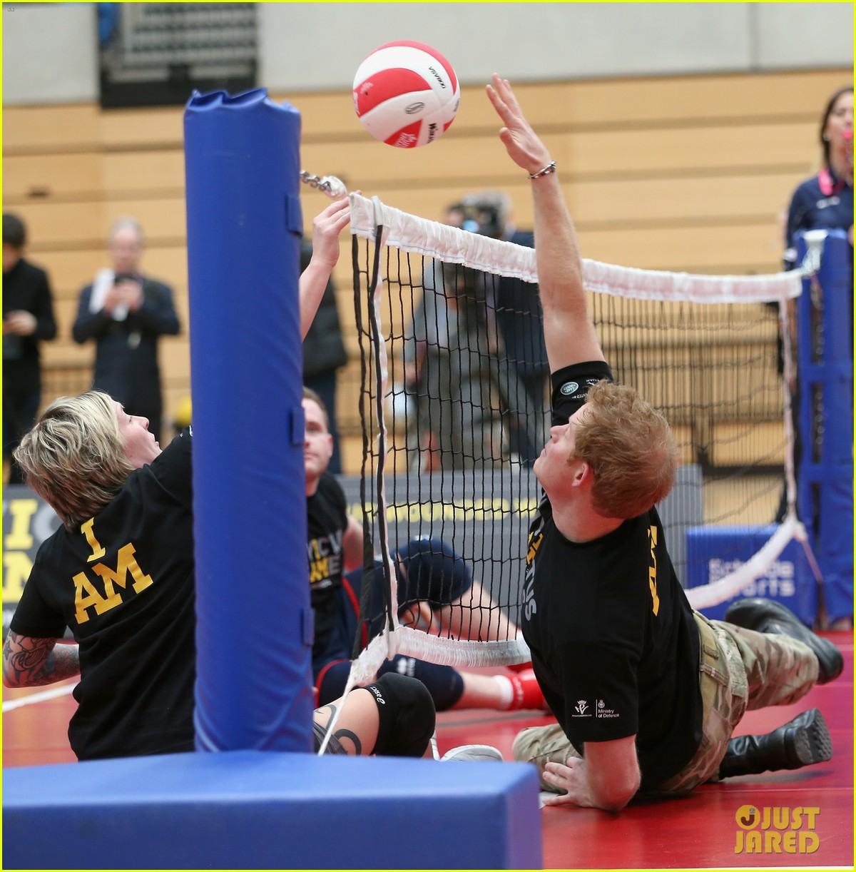 prince harry plays volleyball on the floor with injured soldiers 033067458