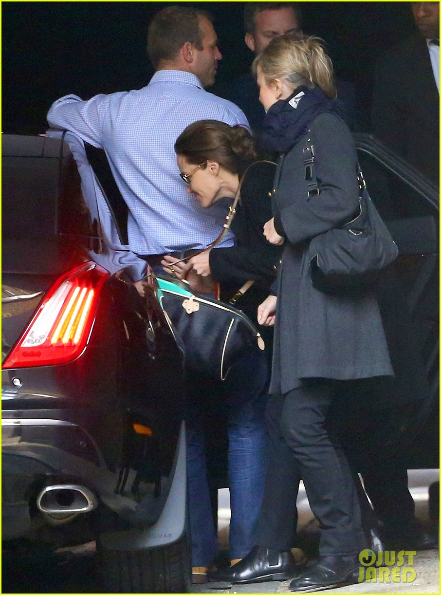 angelina jolie ducks into her car after quick london trip 03