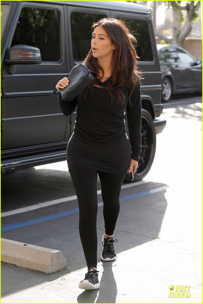 kim kardashian makes a very dark entrance at production office 09