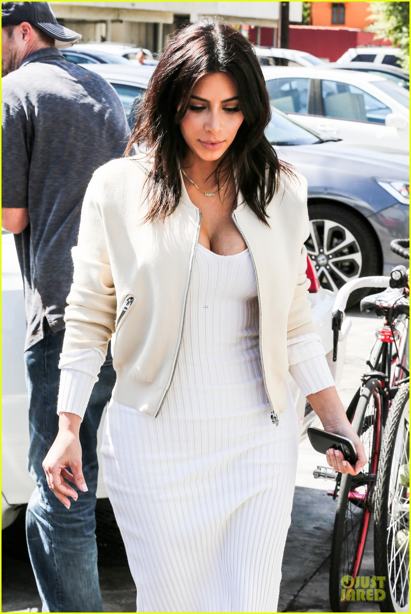 kim kardashian gets ready for summer with white dress 11