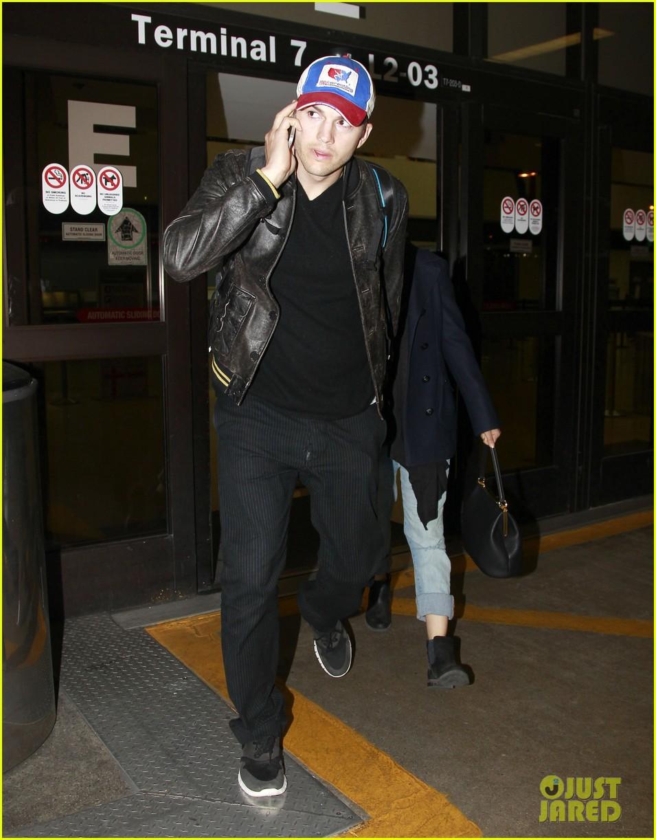 mila kunis ashton kutcher arrive home from iowa 01