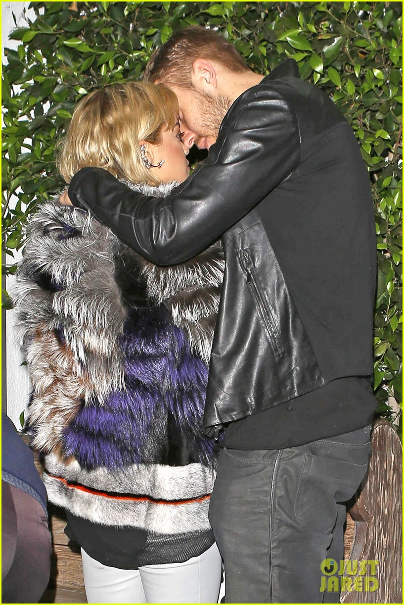 rita ora calvin harris share tender moment 04