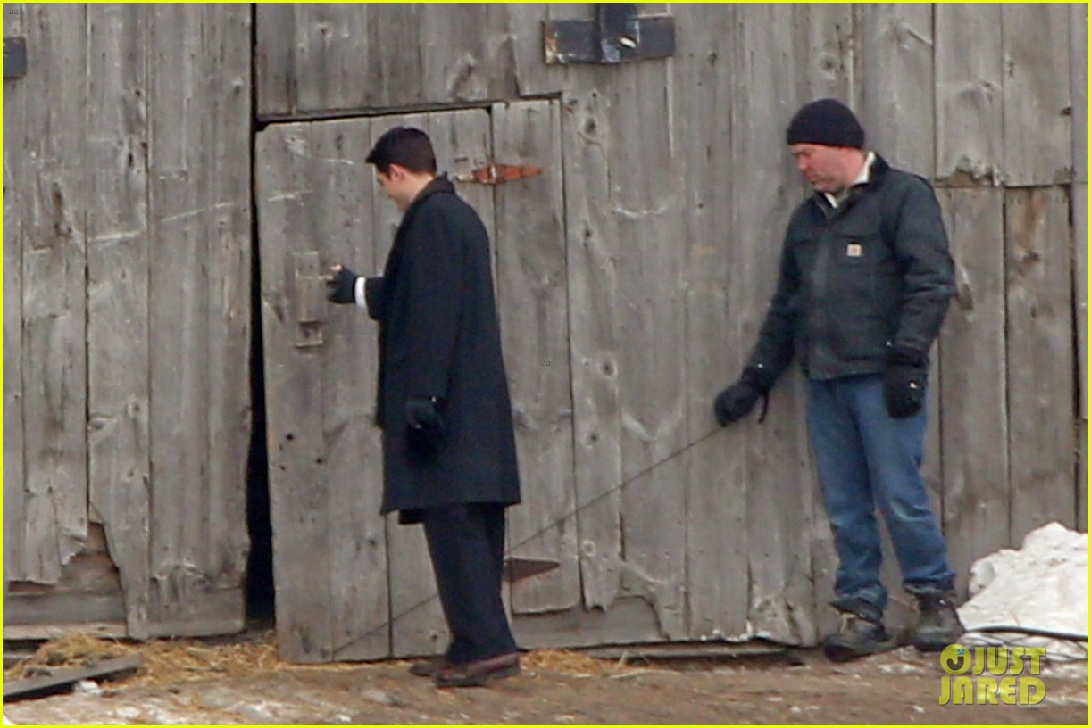 robert pattinson keeps warm with earmuffs on snowy life set 033063248