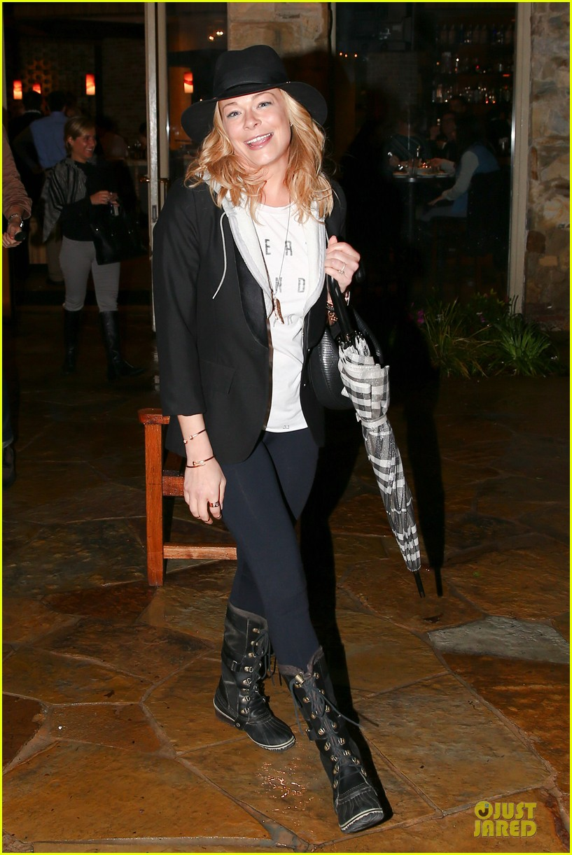 leann rimes fights rain storm with umbrella at tosconova restaurant 05