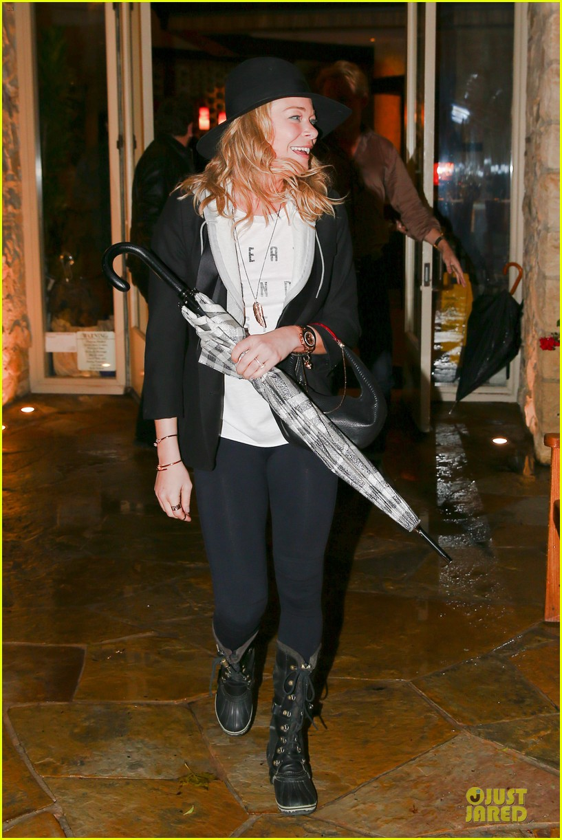 leann rimes fights rain storm with umbrella at tosconova restaurant 163062648