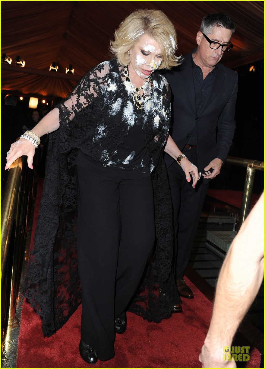 joan rivers gets attacked with cake at gvc red carpet event 033062657