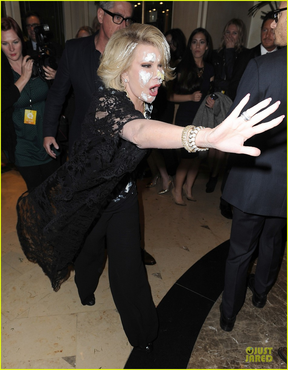 joan rivers gets attacked with cake at gvc red carpet event 053062659
