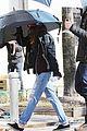 kristen stewart shields herself umbrella 18