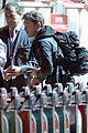 sam worthington arrives at sydney airport with lara bingle 03