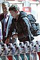 sam worthington arrives at sydney airport with lara bingle 07