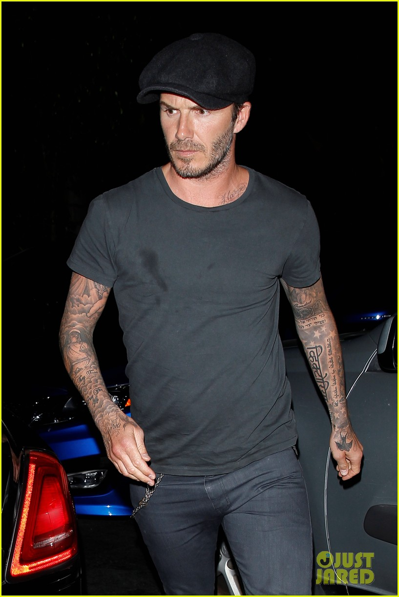 chivalry isnt dead for david beckham as he opens car door for victoria beckham 063086868