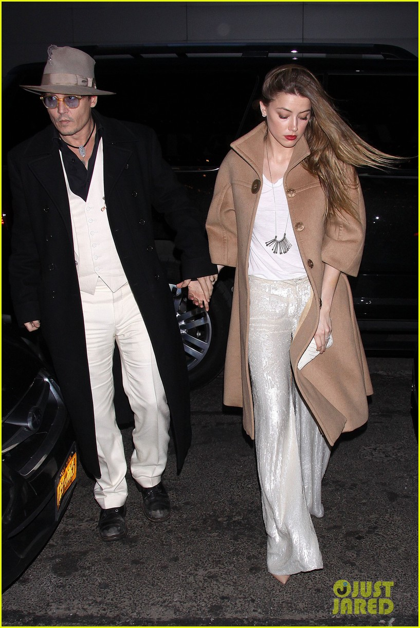 johnny depp amber heard hold hands at cabaret opening 113098568