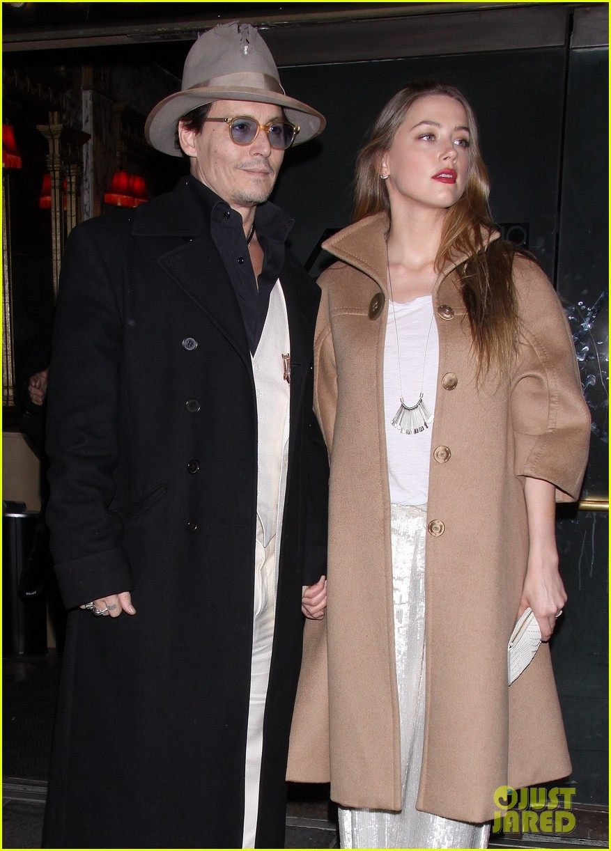 johnny depp amber heard hold hands at cabaret opening 17