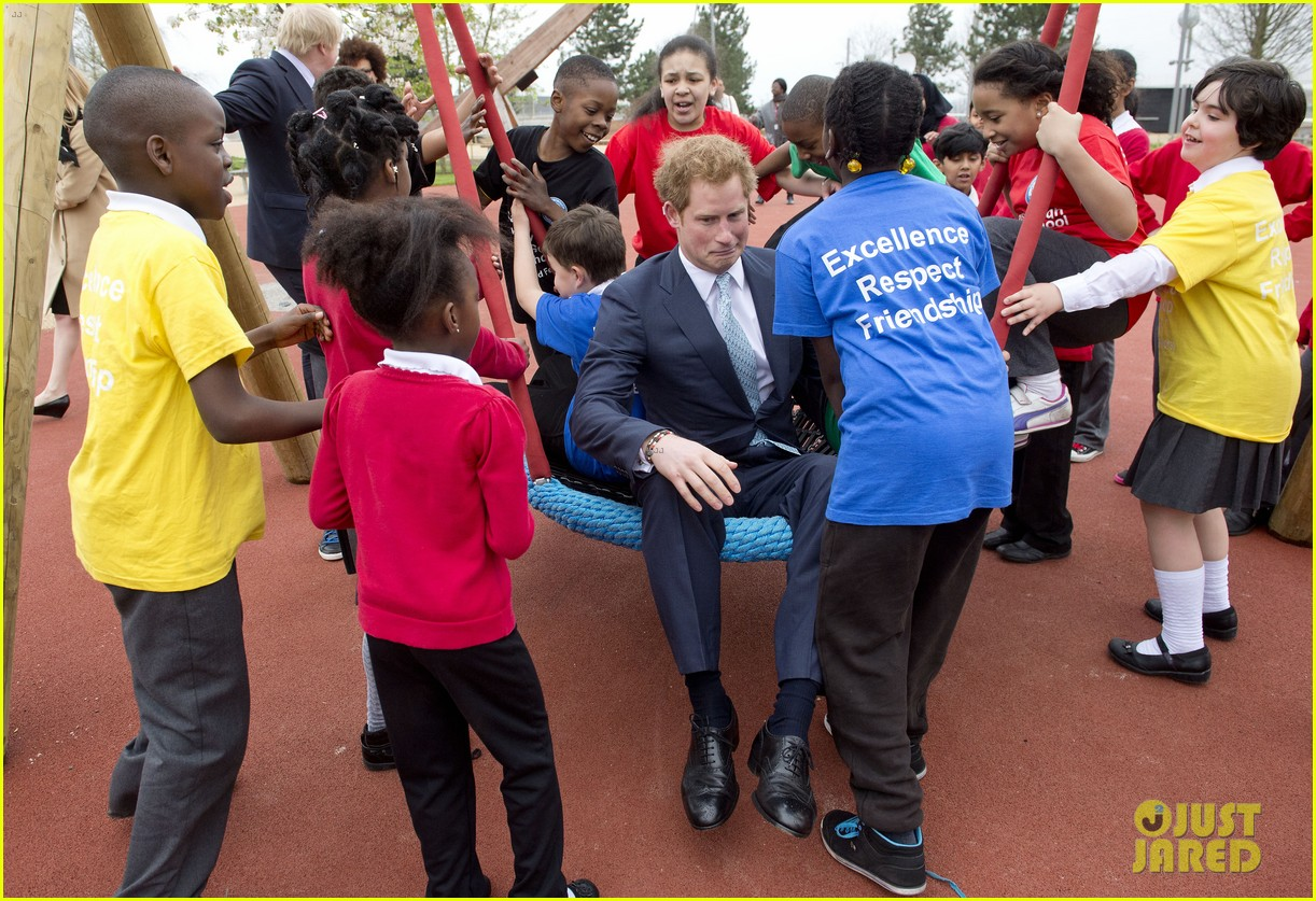 prince harry playing with kids at a playground 10