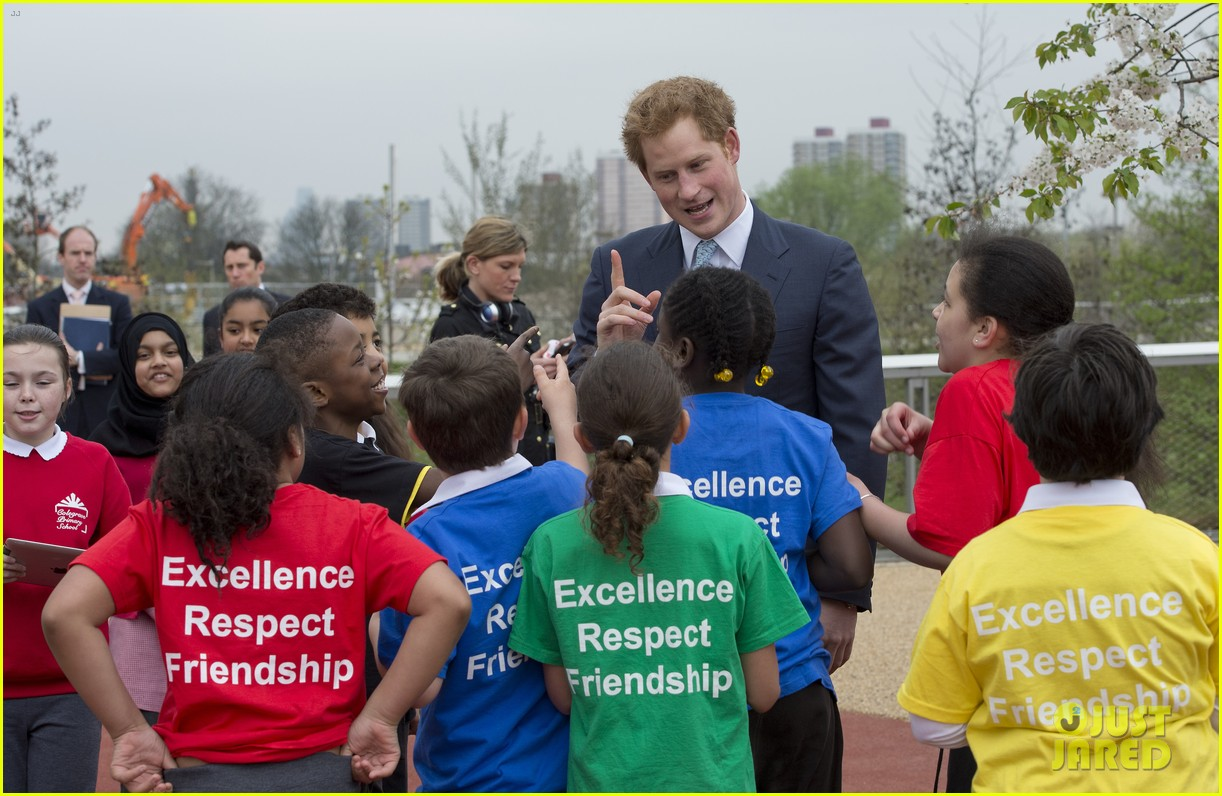 prince harry playing with kids at a playground 123084701